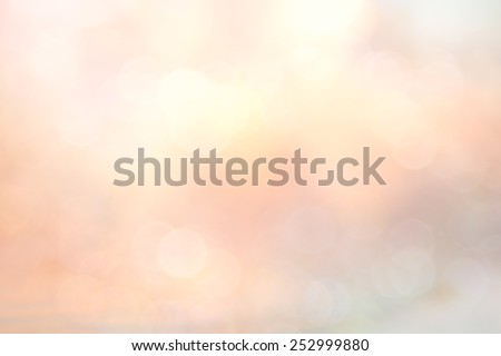 Abstract blurred textured background: orange and pink patterns. Blurred nature background. Sandy beach backdrop with turquoise water and bright sun light. Summer holidays concept. - stock photo