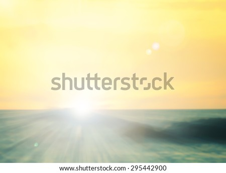 Abstract blurred textured background: yellow orange and blue patterns. Blurred nature background. Beautiful oceans and bright sun light. Summer Holidays, World Environment, Earth Day concept. - stock photo
