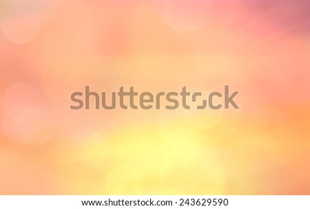 Abstract blurred textured background: yellow orange and pink patterns. Blurred nature background. Sandy beach backdrop with turquoise water and bright sun light. Summer holidays concept. - stock photo