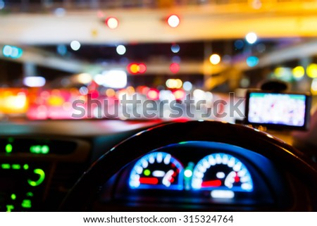 Abstract blurred traffic light on road from driver view, urban lifestyle - stock photo