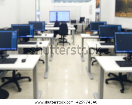 Abstract blurry background: computer classroom - stock photo