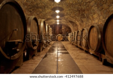 Abstract blurry background of wine cellar - stock photo