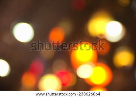Abstract blurry dark background with a lot of bokeh