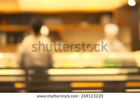 Abstract blurry sushi counter in vintage style decoration restaurant - stock photo