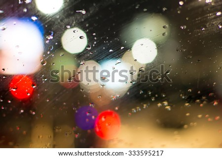 Abstract blurry traffic road bokeh light view from inside a car