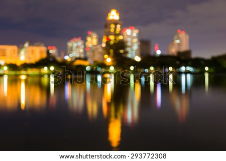 Abstract bokeh city night light with water reflection - stock photo