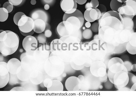 Abstract bokeh festive background with defocused lights