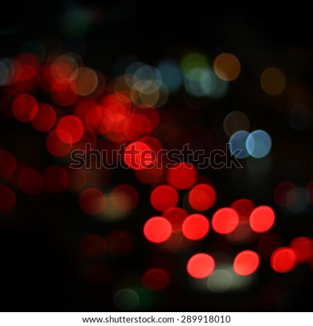 abstract  bokeh light of traffic jam in night city - stock photo
