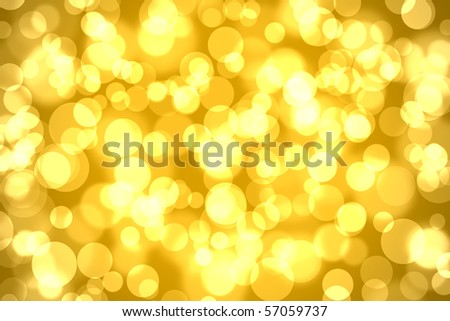 abstract bokeh lights on golden colored background
