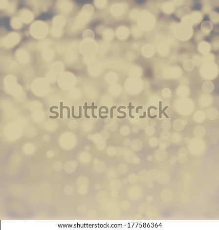Abstract bokeh lights vintage background with defocused golden lights. De focussed background with sparkles, fine art, soft focus, greeting holiday card, festive frame, magic lights - stock photo