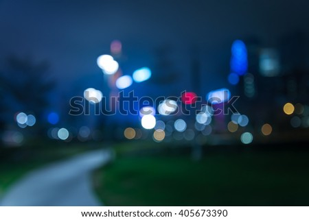 Abstract bokeh night garden in city background - stock photo