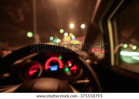 Abstract bokeh of car speed meter light dashboard with traffic  light at night