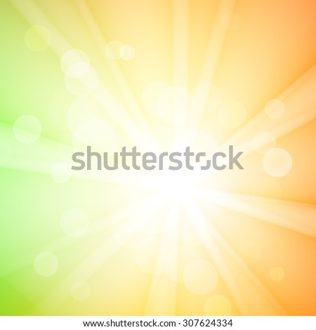 Abstract bokeh sparkles on yellow blurred background - stock photo