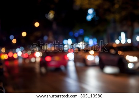abstract bokeh traffic light in night time for background - stock photo