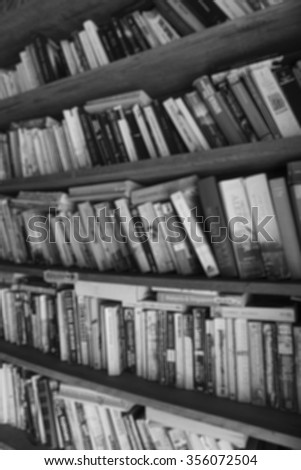 abstract bookshelf background with black and white - stock photo