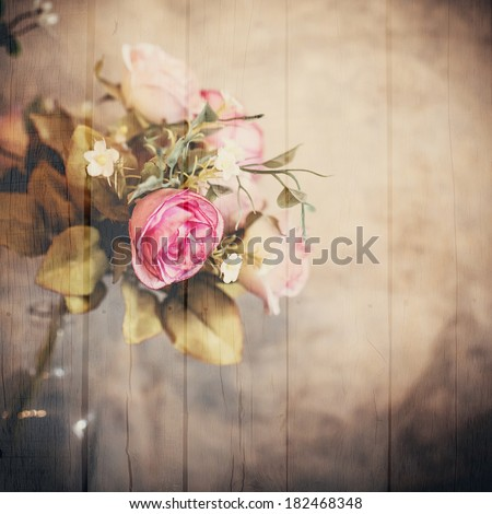 Abstract Bouquet of roses flower with wooden textured effect.