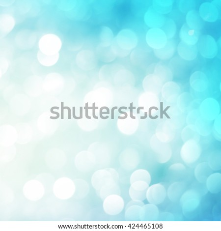 abstract bright blur blue teal cyan bronze glittering shine bubble lights background:blurred of vivid wallpaper concept.banner template design festival backdrop:sparkle circle:square image display  - stock photo