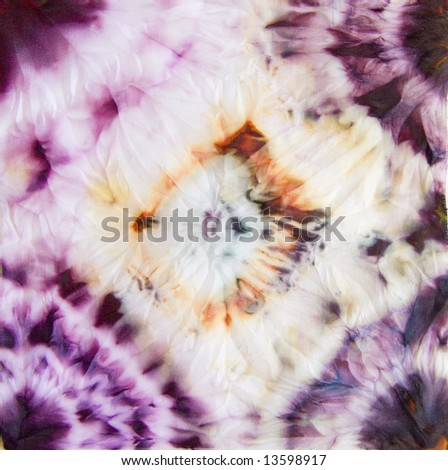 Abstract bright textile in batik's technique - stock photo