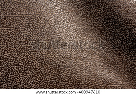 Abstract brown leather texture. Background and texture for design. - stock photo