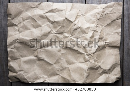 Abstract brown recycle crumpled paper for background . crease of brown paper textures background for design,decorative.