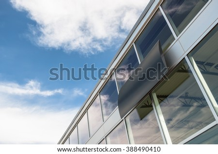 Abstract business building exterior, view of sky - stock photo