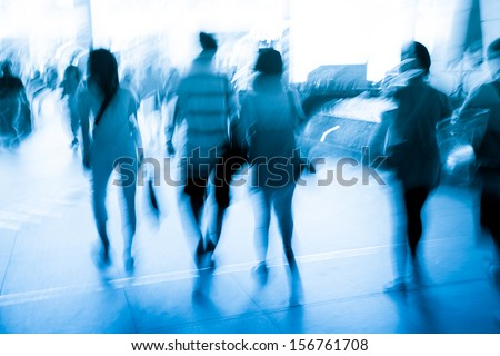 abstract business people walking on city street, motion blurred. - stock photo