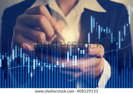 Abstract business stock communication background with hand holding smart phone and pen