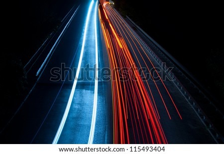 Abstract car lights in a tunnel in blue and red. Picture taken with long exposure - stock photo