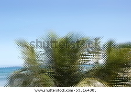 Abstract caribbean palm tree leaves in motion. Green leaves in retro style moving in summer wind on tropical beach, for travel blog, design template, magazines. Image with wave rippled filter effect