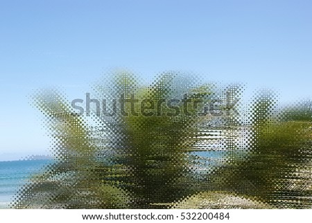 Abstract caribbean palm tree leaves in motion. Retro style branches moving on tropical beach, ideal for travel blog, design template, print magazine. Image with rippled glass filter effect