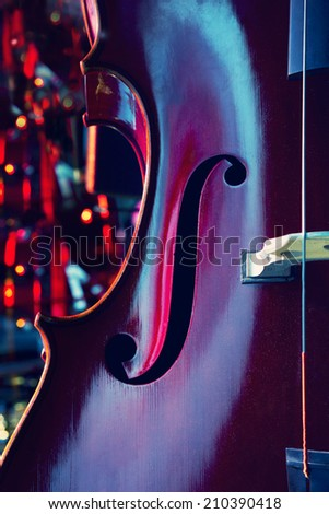 Abstract cello image showing the f hole - stock photo