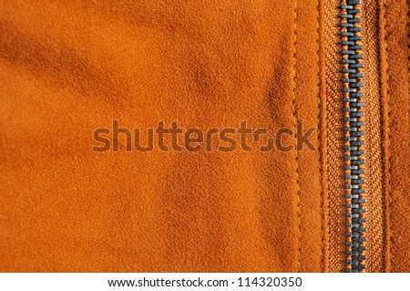 Abstract chamois background with seam and zip fastener - stock photo