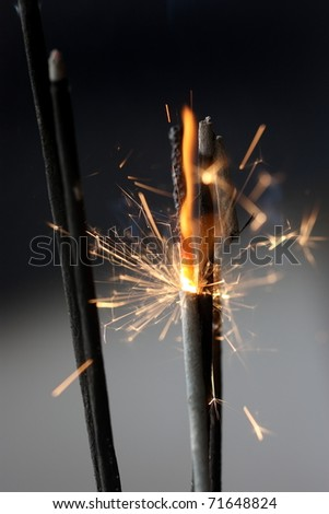 abstract chaos fire sparks on dark background