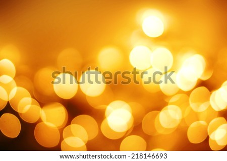 Abstract Christmas background with gold bokeh lights  and place for text. Beautiful Festive textured  background. Vintage defocused background.