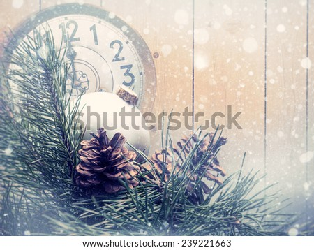 Abstract christmas backgrounds with xmas decorations, old watches and wooden desk