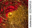 Abstract Christmas decoration with golden ball and golden tinsel - stock photo