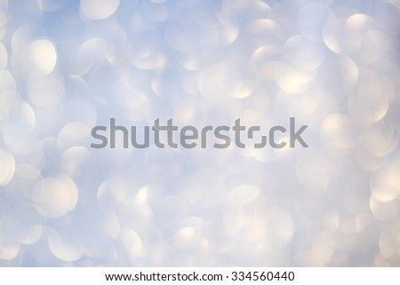 Abstract christmas festive background. Golden holiday bokeh on a light blue background.