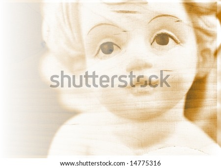 Abstract christmas or nostalgia background with face of little angel on bright texture