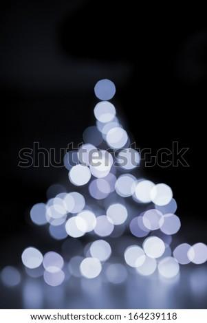 Abstract Christmas tree lights on black - stock photo