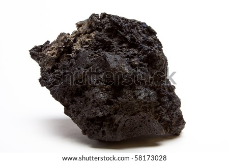 Abstract chunk of Lava Rock from low perspective isolated against white. - stock photo