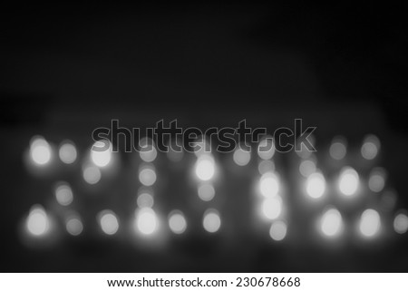 Abstract circular bokeh background of candlelight and Christmaslight on dark night
