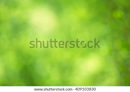 Abstract circular green bokeh background. - stock photo