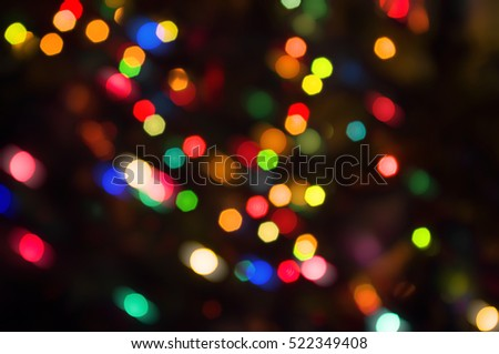 Abstract circular lights blurred bokeh holiday background of Christmas light