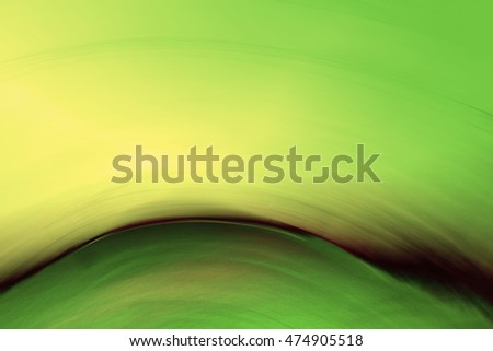 Abstract circular motion blurred background in dark green,yellow