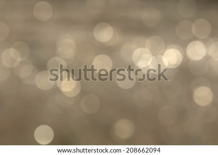 Abstract circular natural light orange bokeh background - stock photo