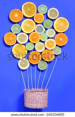 Abstract Citrus fruits and basket - stock photo