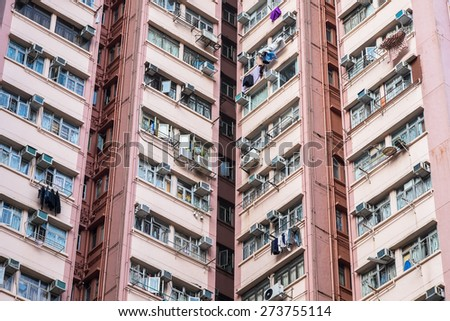 Abstract city background. Apartment building in Hong Kong - stock photo