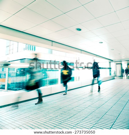 Abstract city background. Blurred image of people moving in tunnel at crowded street. Hong Kong. Blur effect, vintage style toning - stock photo