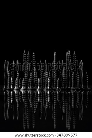 Abstract city of screws on black background