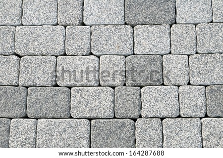 Abstract cobblestone pavement texture background - stock photo